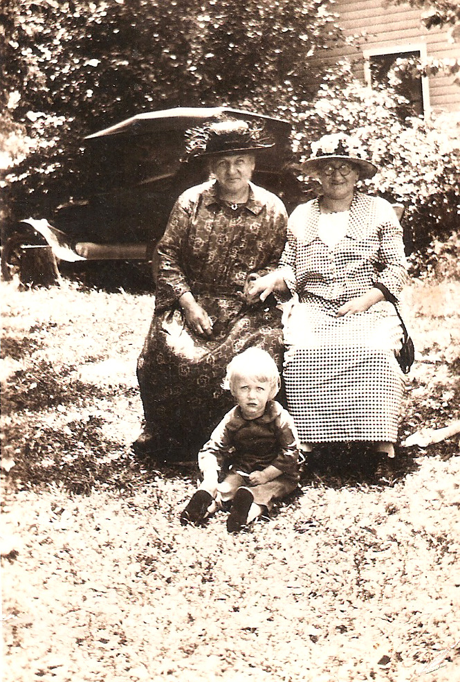 Anna (left) and two unknown individuals.