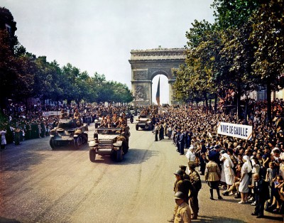 Crowds of French patriots line the Champs Elysees to view Free French tanks and half tracks of General Leclerc's 2nd Armored Division passes through the Arc du Triomphe, after Paris was liberated on August 26, 1944.